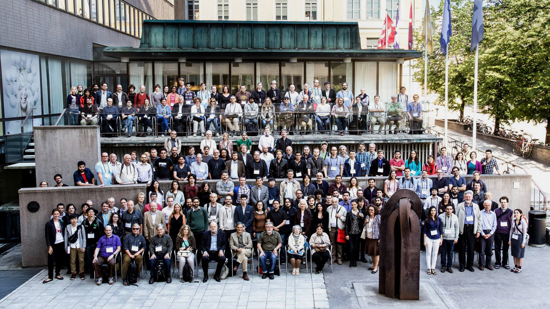 A large group picture in front of University of Helsinki