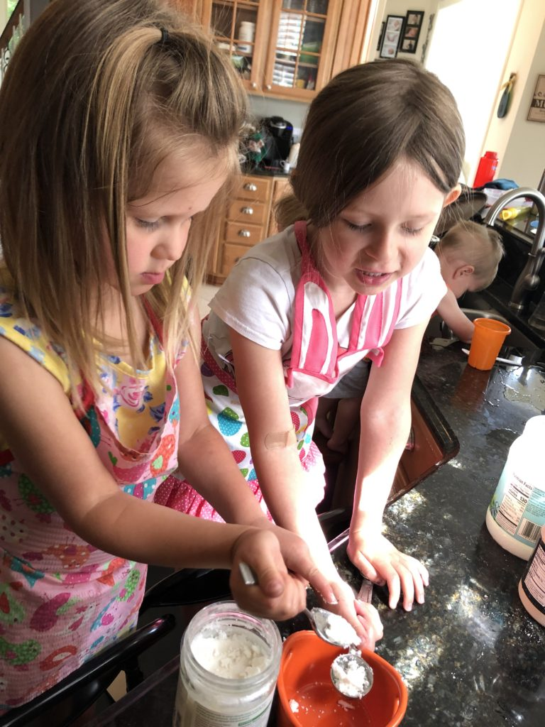 The girls creating summer memories by making donuts