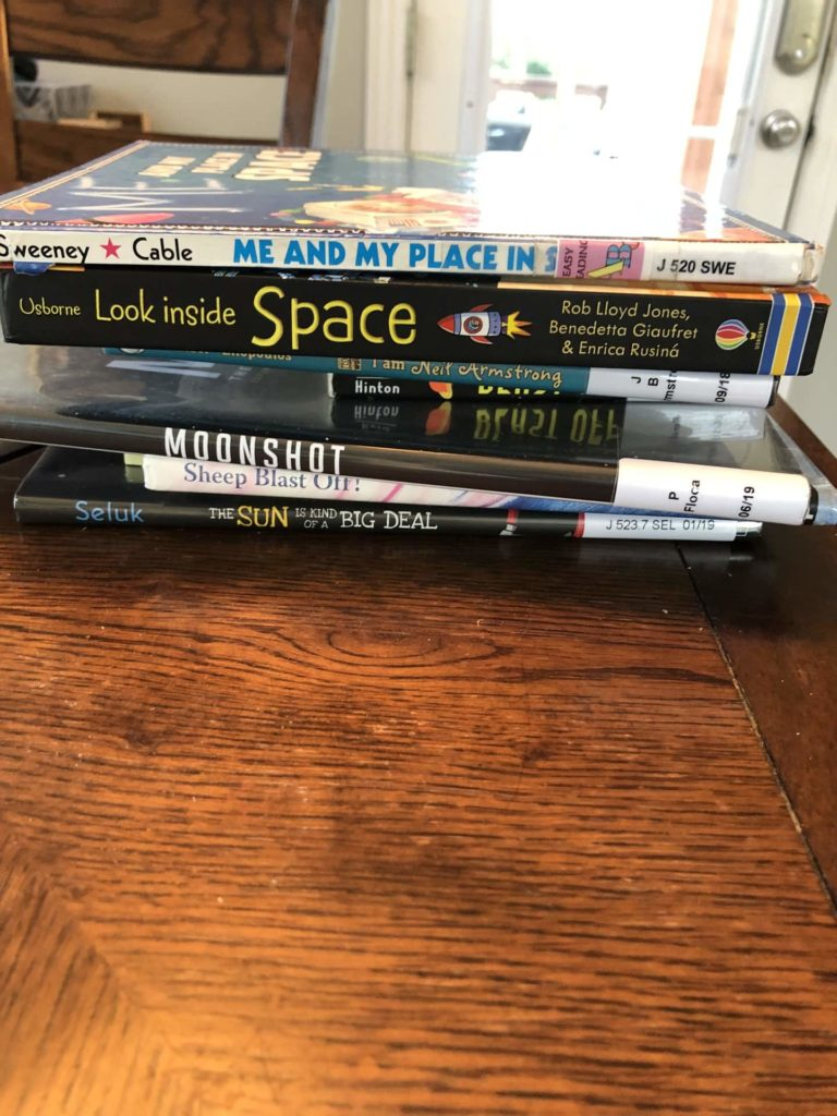 A stack of books to start our exploration of space for preschool kindergarten.