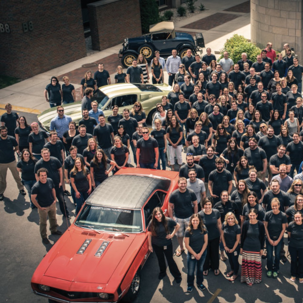 Hagerty team photo in parking lot of Hagerty headquarters