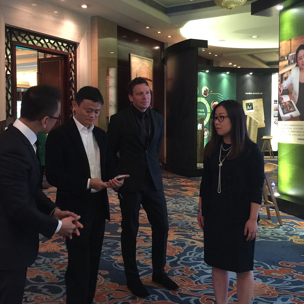 Images of Kelly Smith and Jack Ma, Alibaba founder.