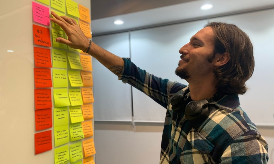Me pointing to a specific post-it.