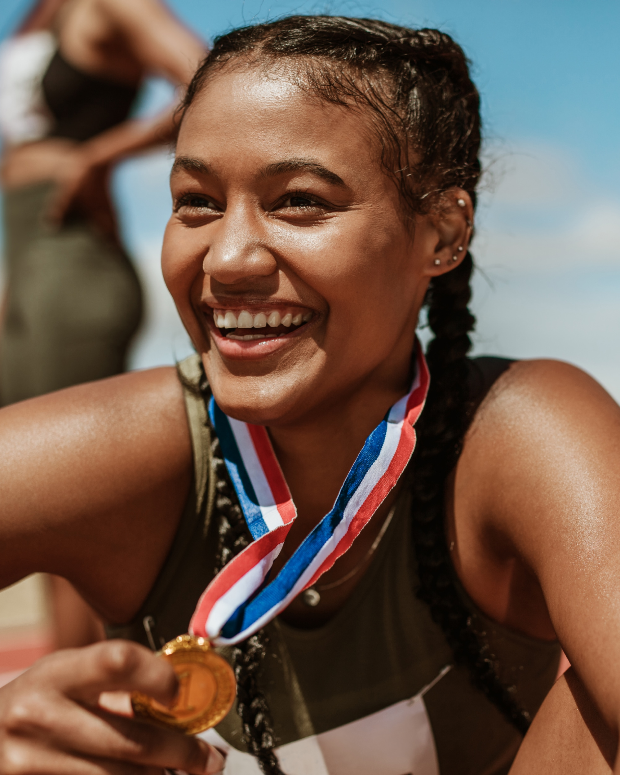 Girl with sports medal