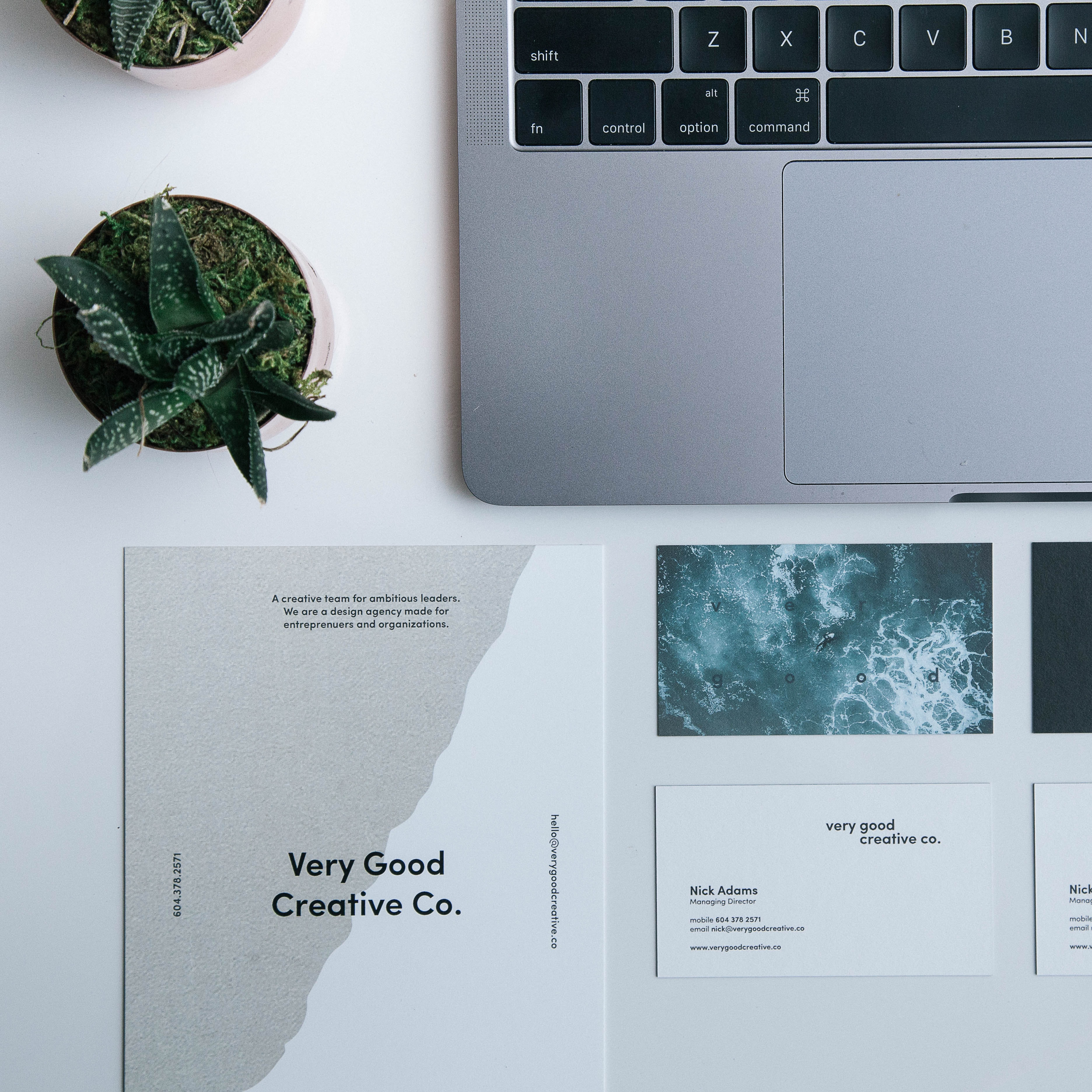 Top 0down shot of a laptop and a branding pack