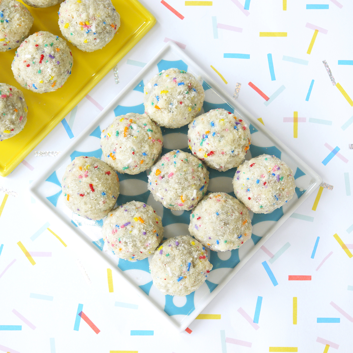 birthday cake truffles on sprinkle background in flat lay style