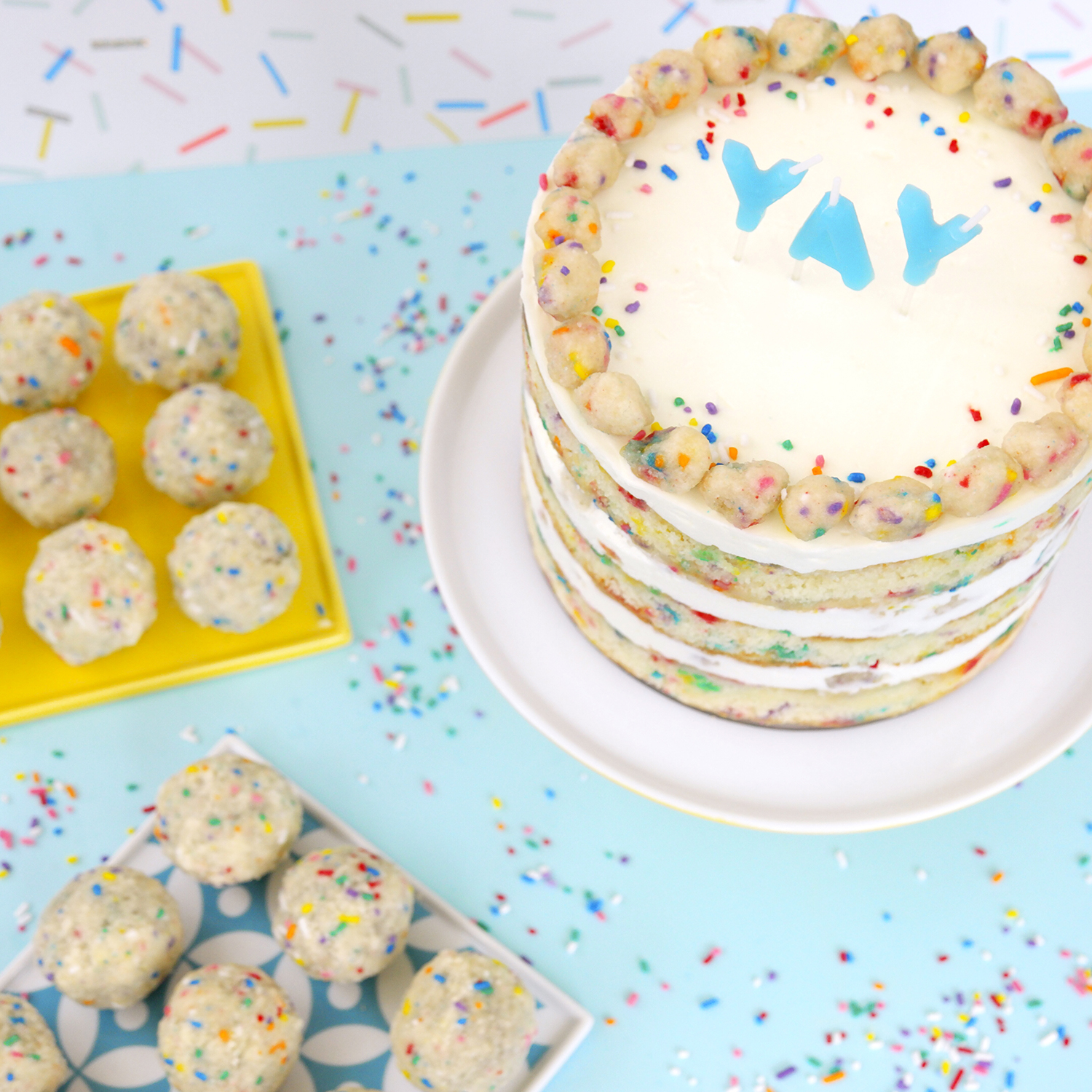milk bar birthday cake with yay candles and sprinkles
