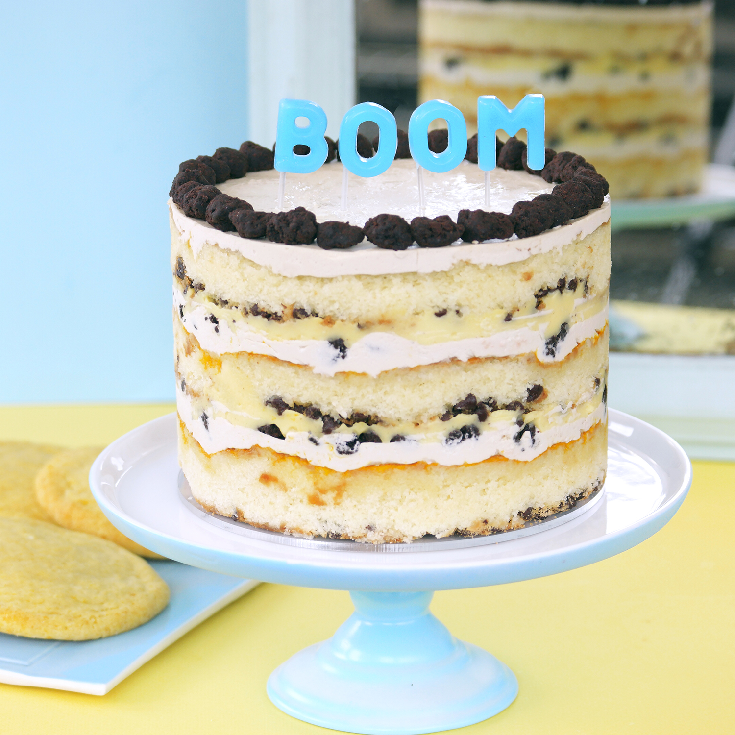 chocolate chip cake with blue boom candles