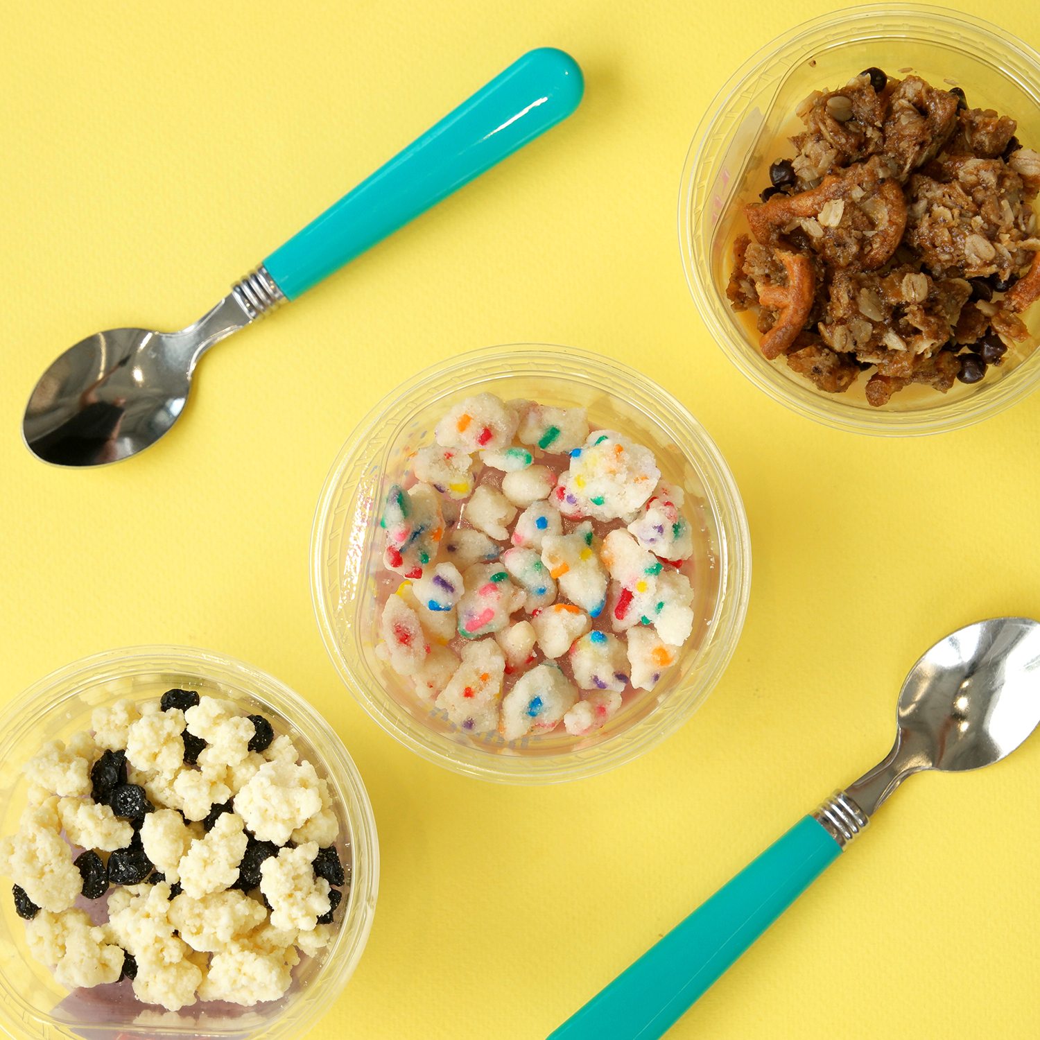 yogurt parfait cups with spoons in flat lay style