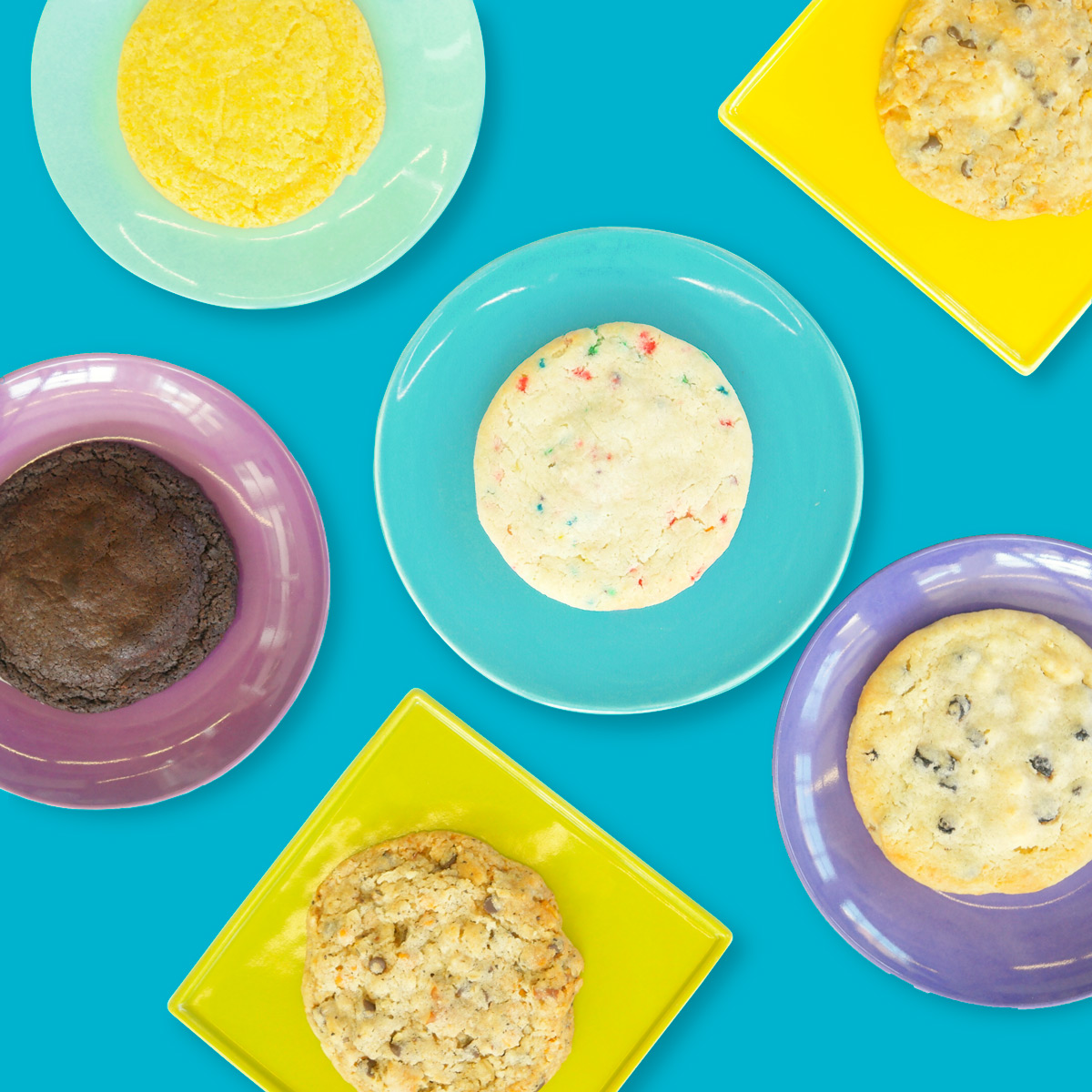 flat lay photograph of cookies on multiple plate colors in style of candy minimalism