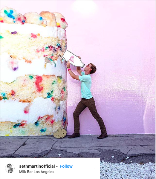 Instagram Post of a man in front of the cake mural