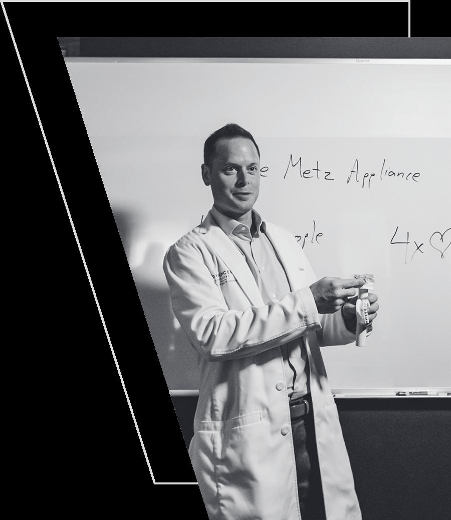 Photo of Dr. James Blank holding a dental model