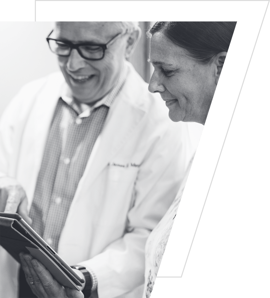 Photo of Dr. James Metz and a patient looking at an iPad