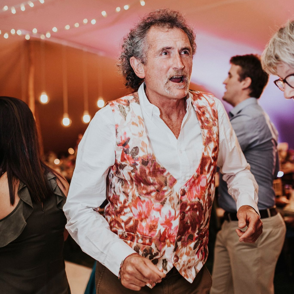 A father and son having a fantastic time at a Groot Constantia wedding, thanks to Cape Town wedding DJs, The DJ Company.