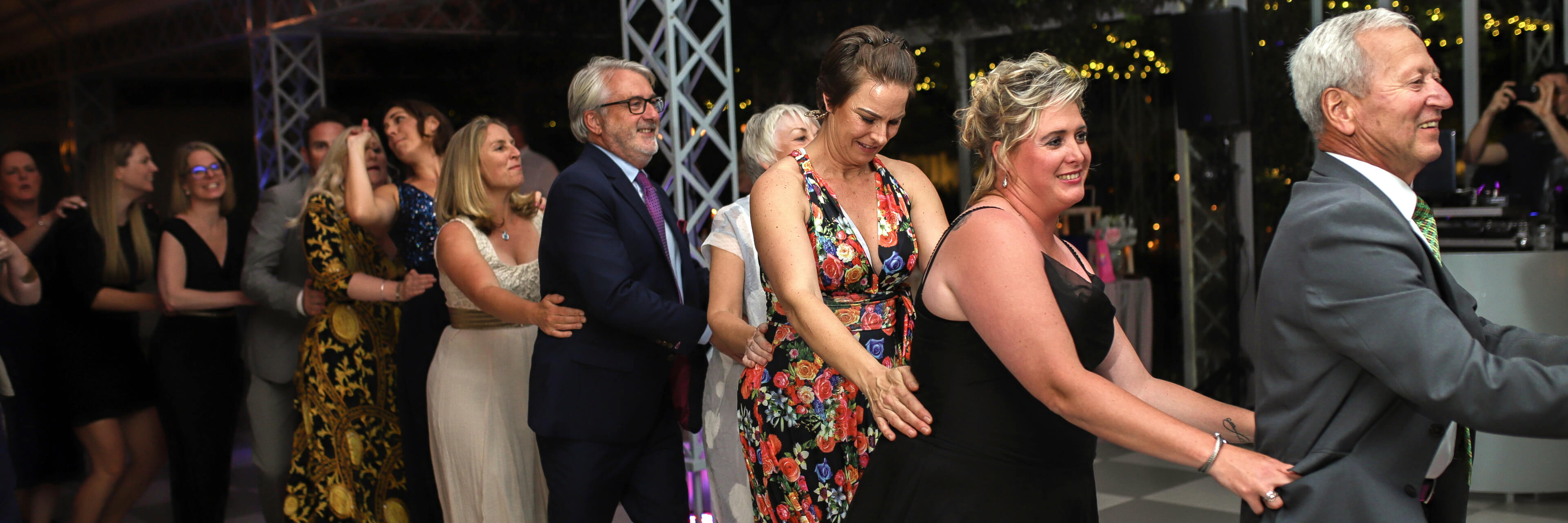 People doing the locomotion at a Stellenbosch wedding at Belair Pavilion.