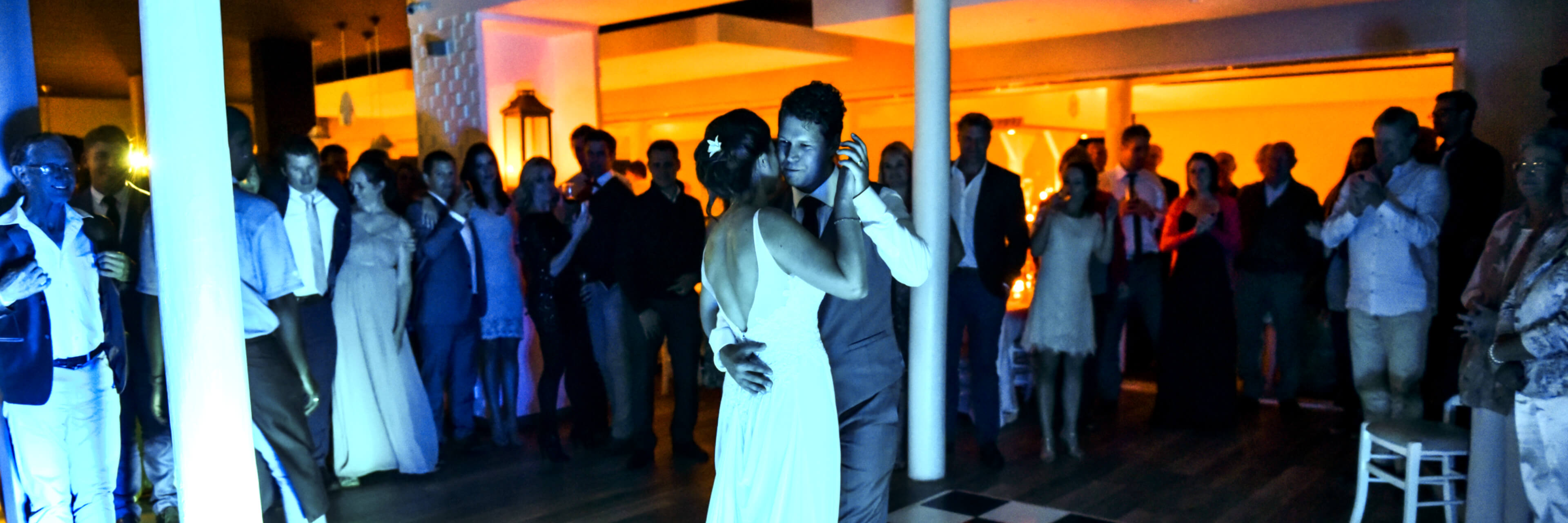 A bride and groom having their first dance with beautiful mood lighting.