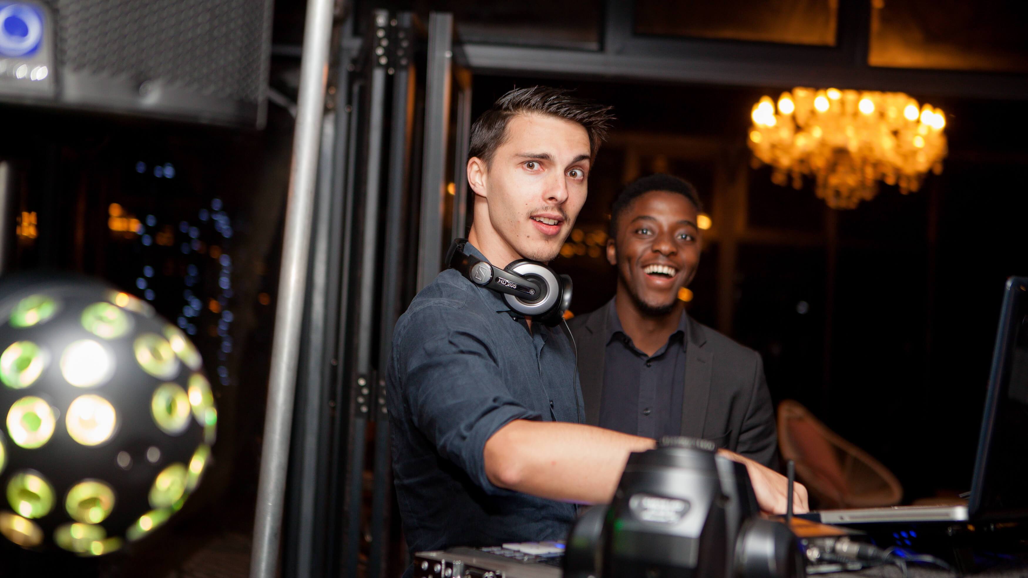 A handsome DJ and his friend playing the best wedding music.