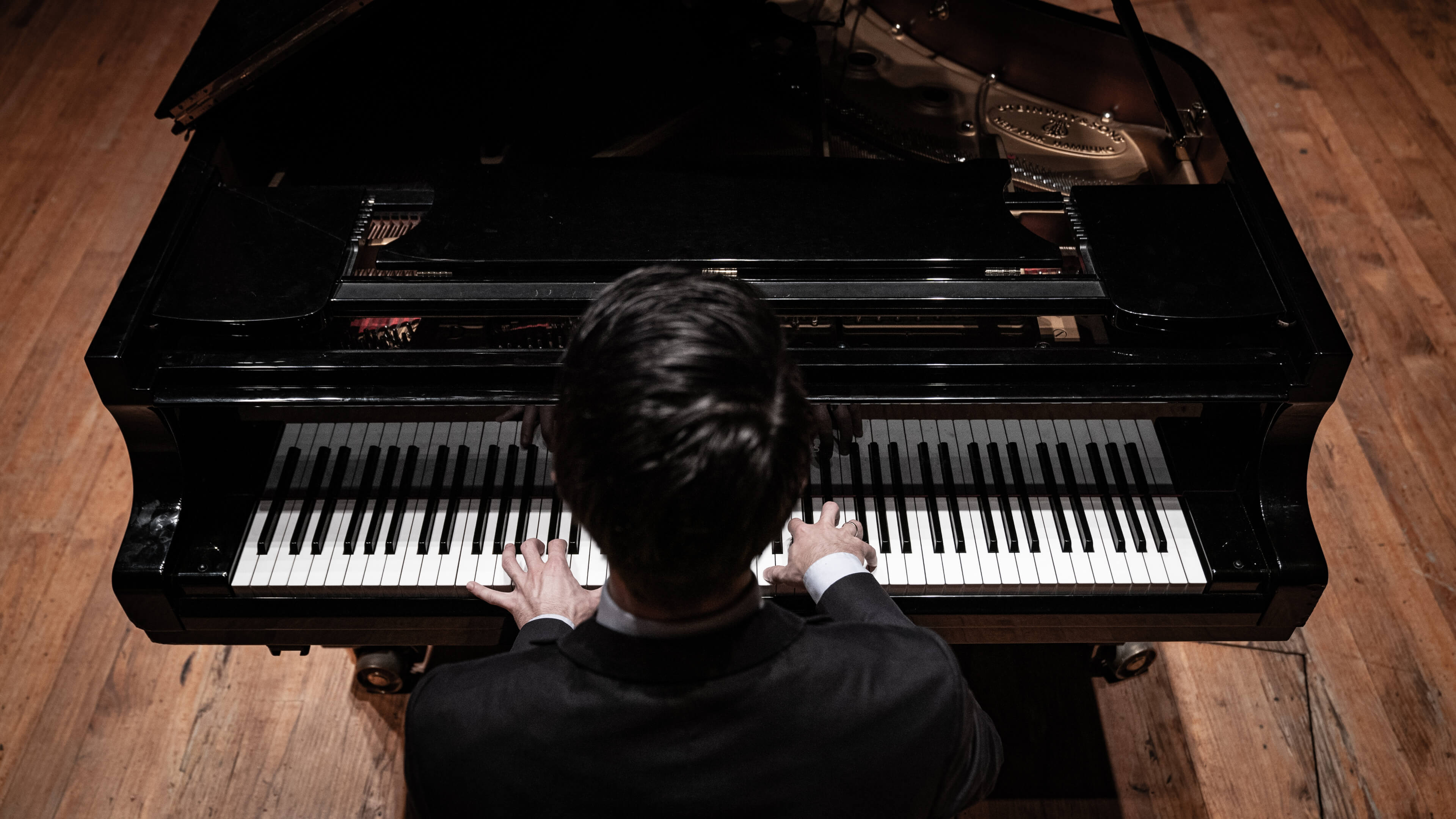 A pianist photographed from above.