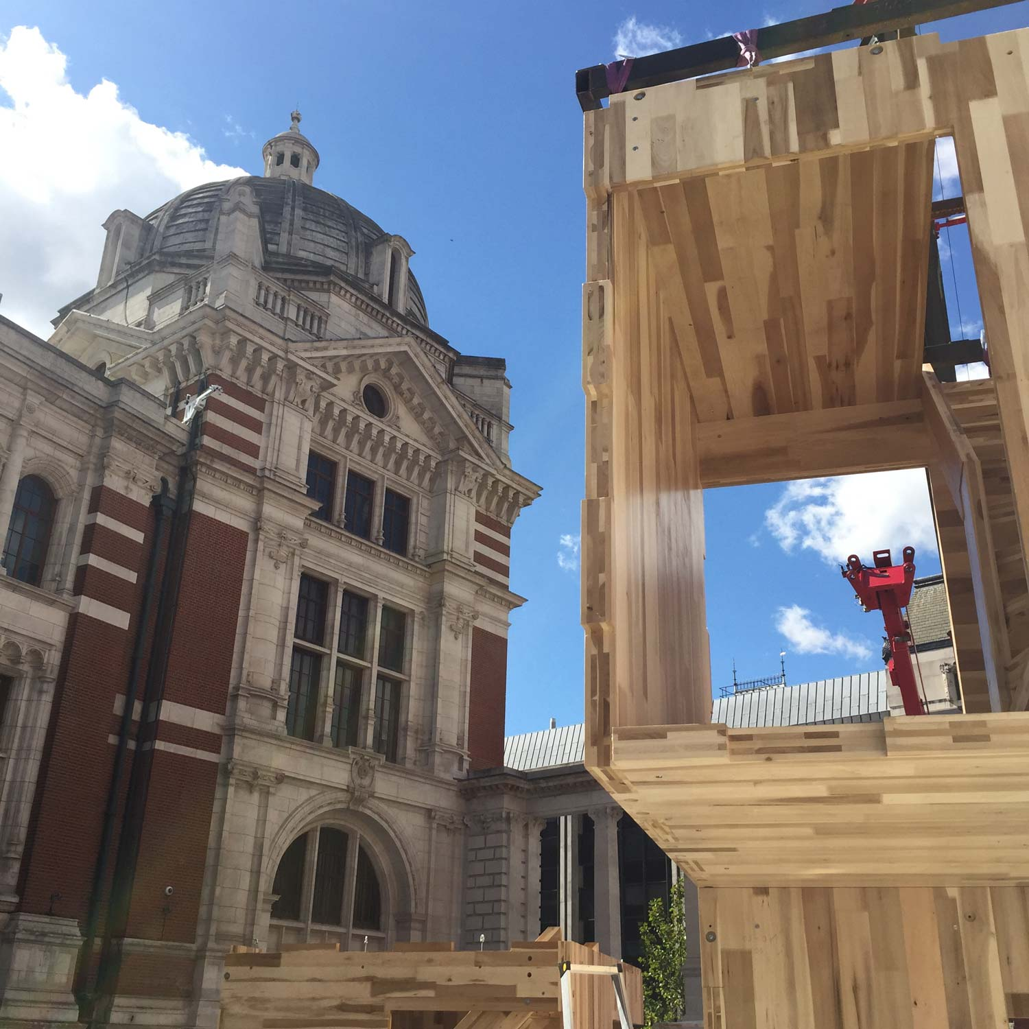 Re-configurable modular timber pavilion, Multiply, being constructed at the at the Sackler courtyard, V&A museum