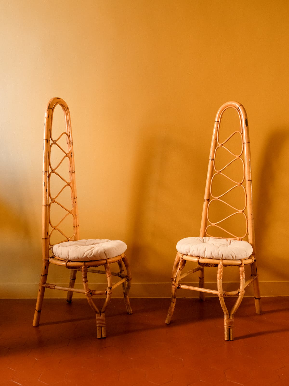 Pair of high back rattan chairs, 60's