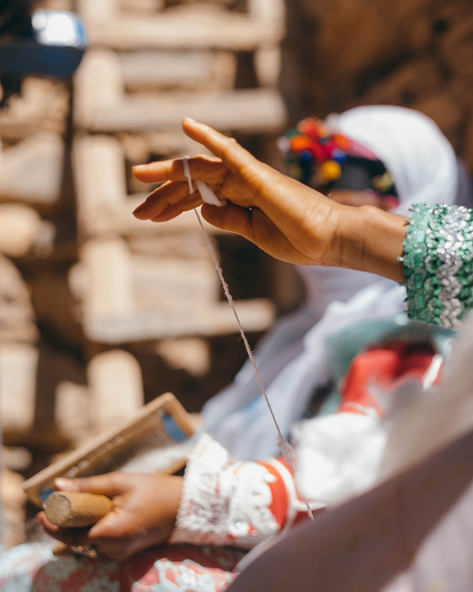 A Moroccan woman weavers from the Anti Atlas spinning cotton by hand