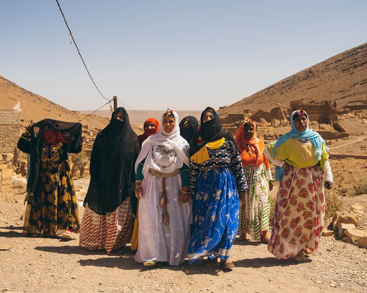 A group of women weavers walk in the Anti Atlas mountains.