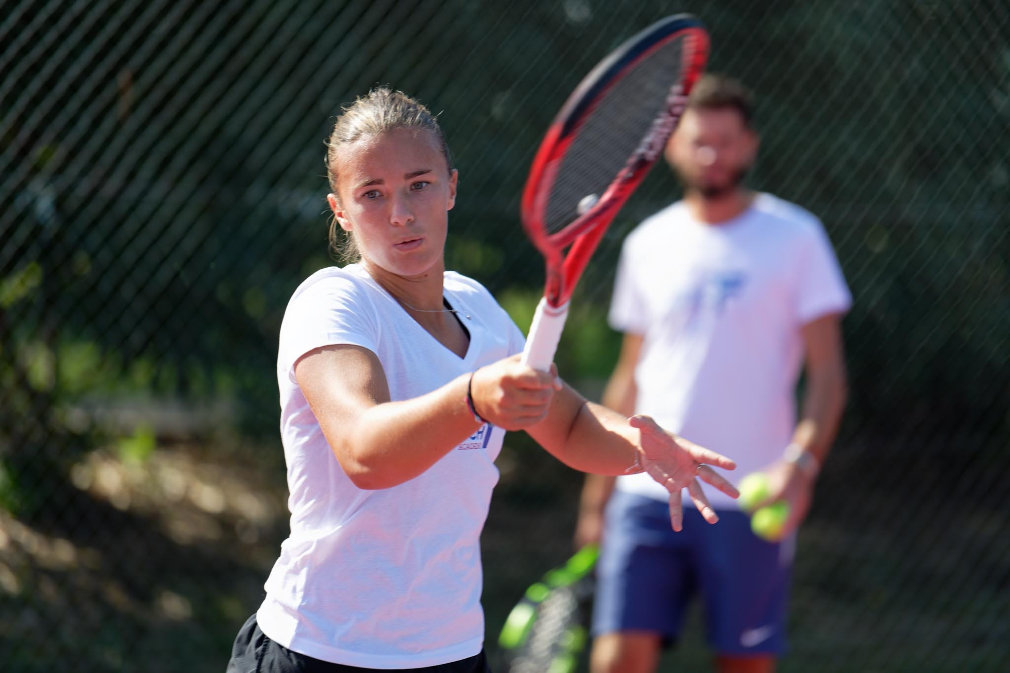 Profesionnal tennis player with her coach Bastien Fazincani