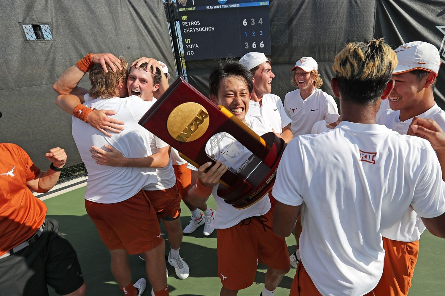 A team of  tennis players from a US university after a victory