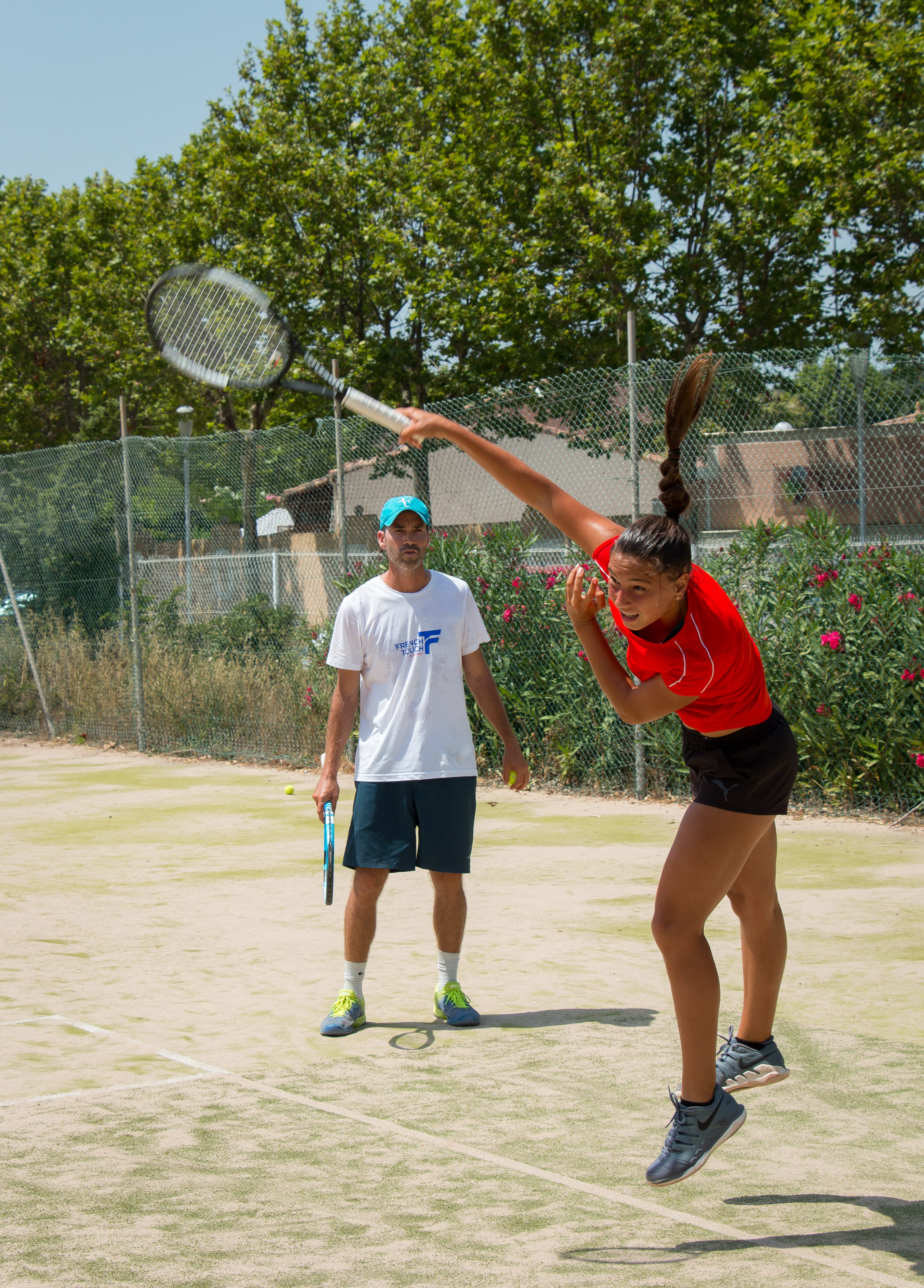 Tennis player with her coach on the court