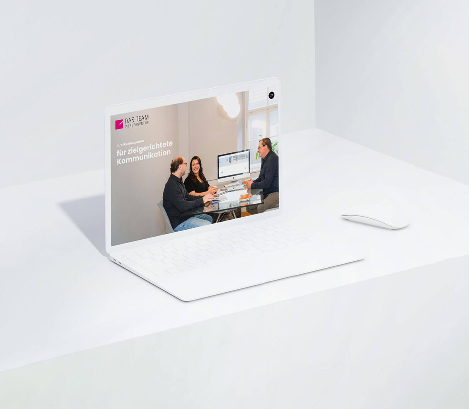 White Laptop on white table