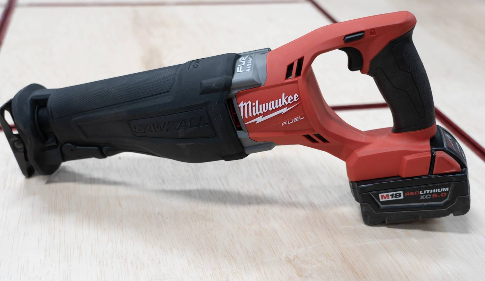 Milwaukee M18 FUEL Cordless SAWZALL Reciprocating Saw on a wooden table