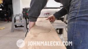 john malecki cuts wood panels for his french doors