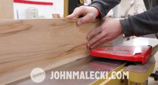 John Malecki saws his DIY door panels