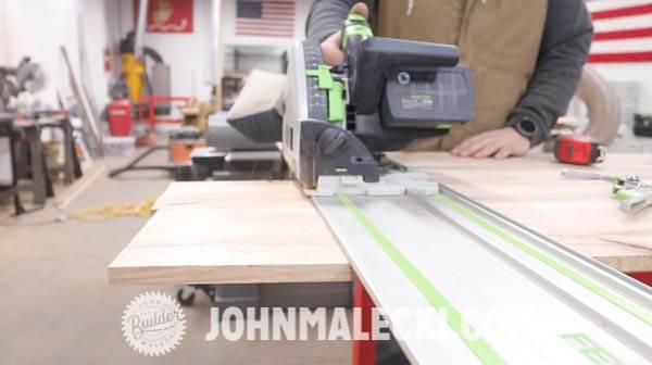 John malecki sands edges of his DIY panel doors
