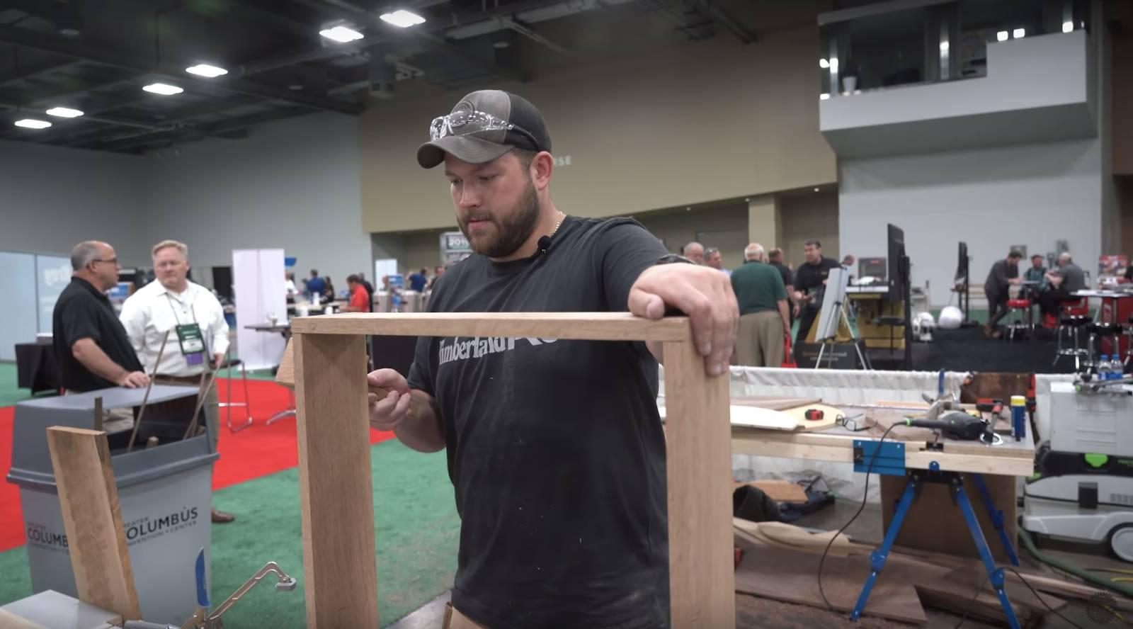 John Malecki assembles the frame for a DIY dartboard cabinet
