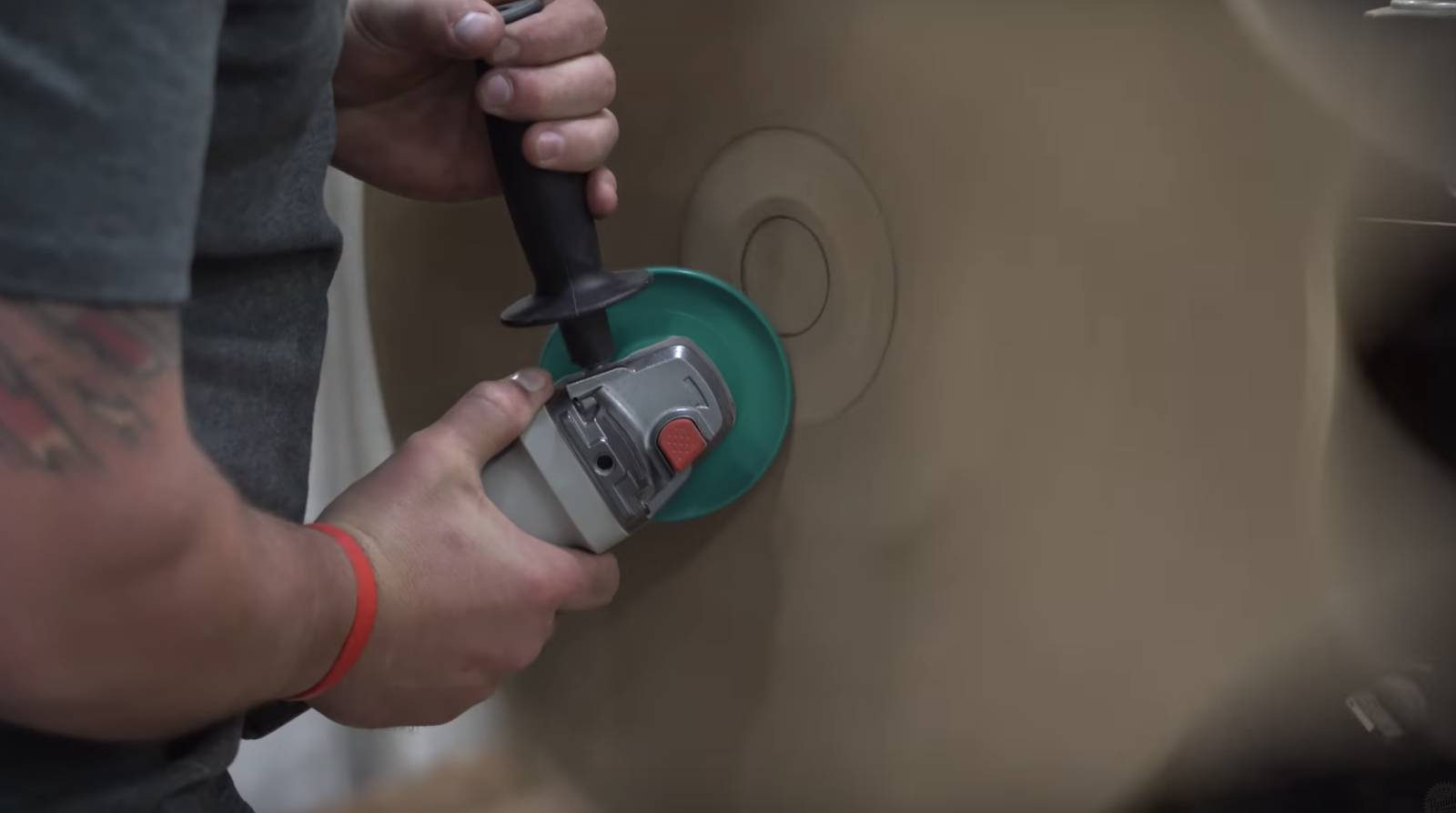 John malecki uses angle grinder on a turning piece of wood