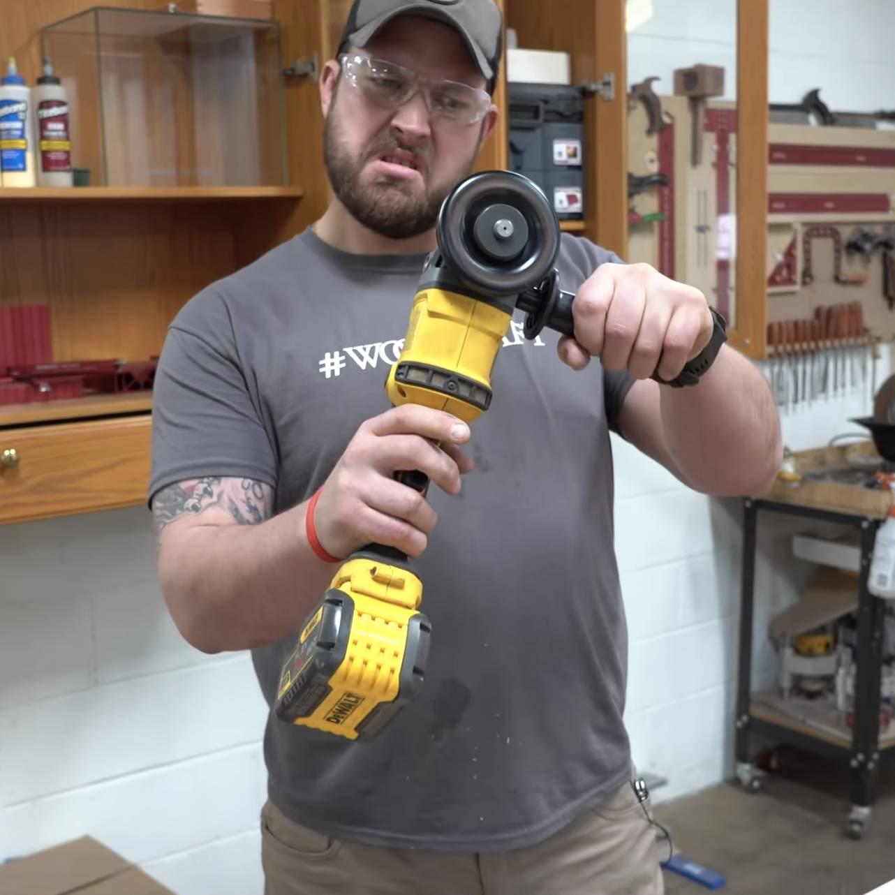 John Malecki uses an angle grinder