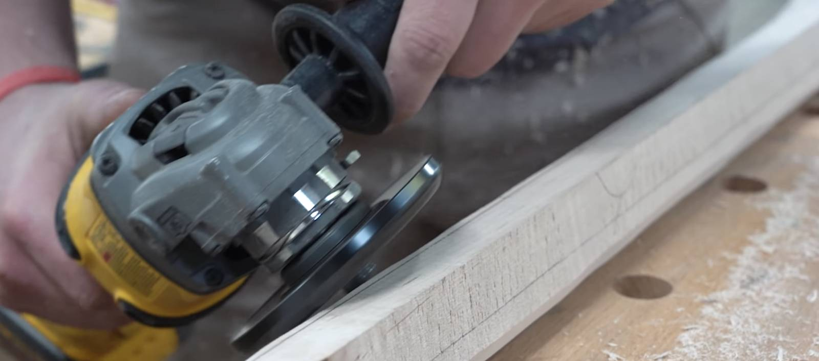John Malecki rounds the handle to his DIY pizza peel with an angle grinder