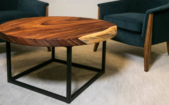 wood slab coffee table next to two chairs