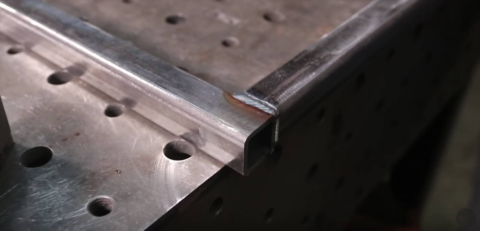 the welded corner of a wood slab coffee table