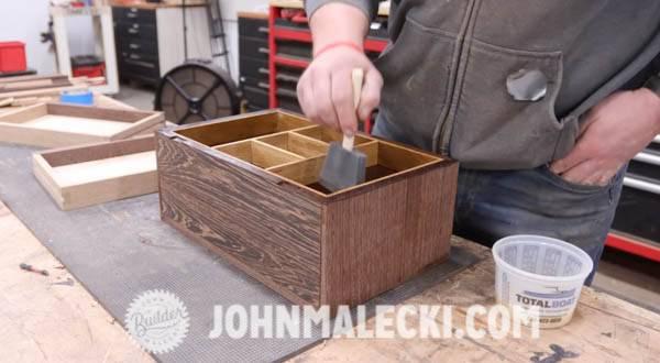 John Malecki sands and shellacs the jewelry box