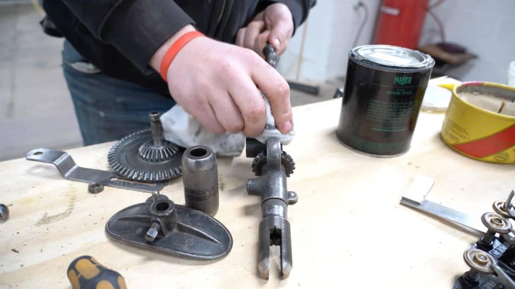 John Malecki buffs and waxes old tools