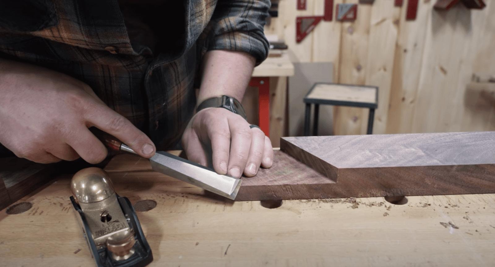 John Malecki making the wood shape