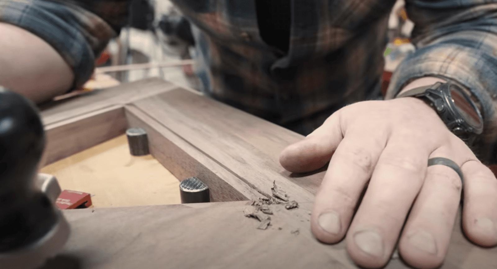John Malecki making a line in wood