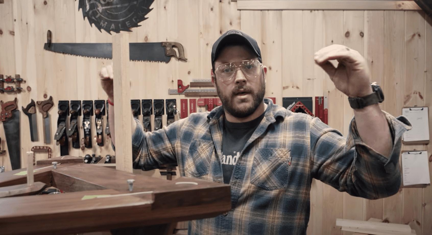 John Malecki with a saw