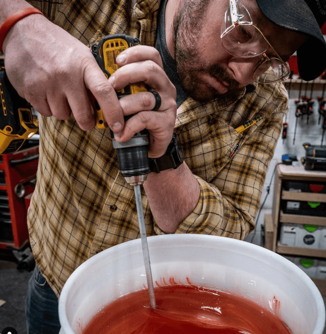 john malecki mixing orange epoxy