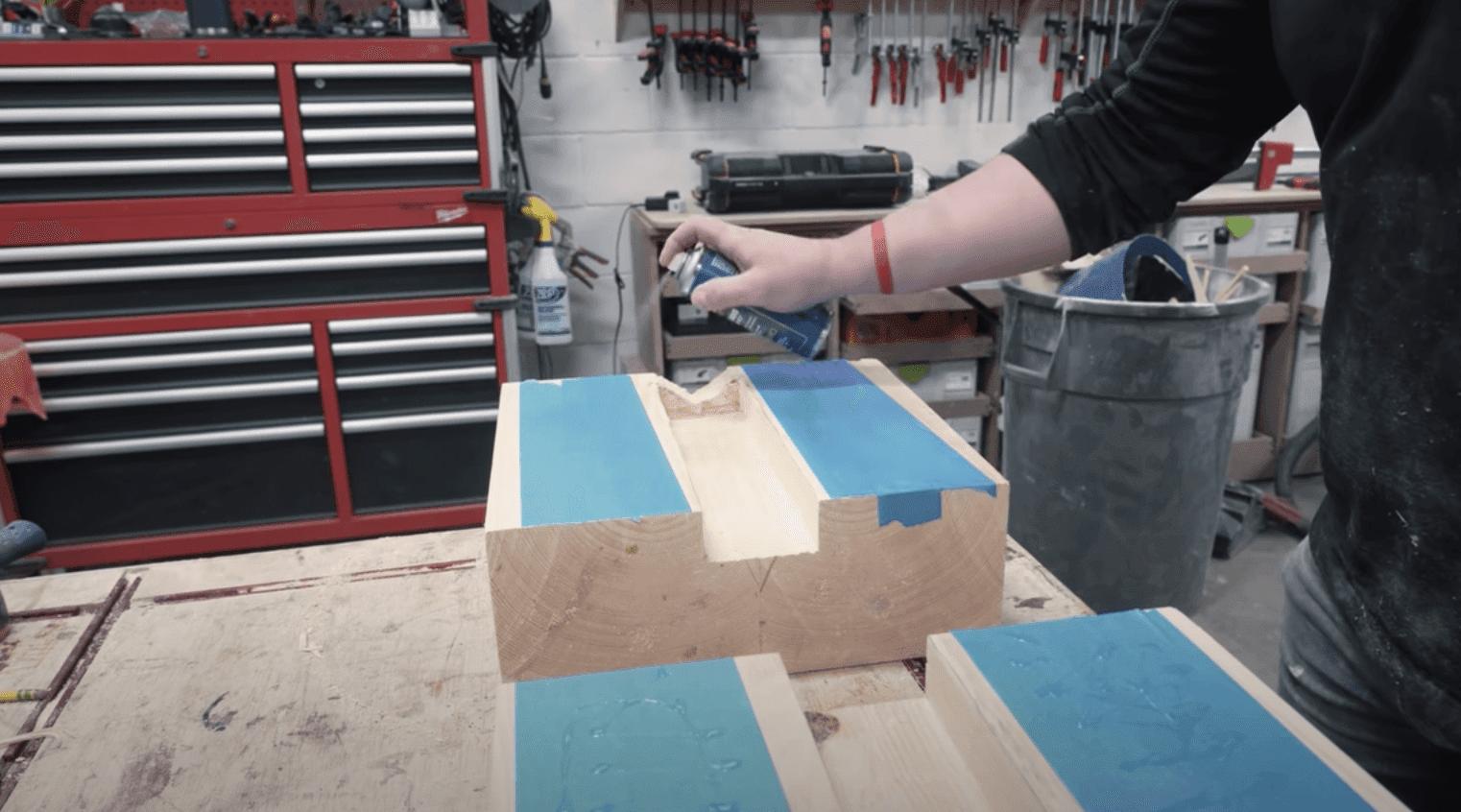 spraying activator on wooden blocks