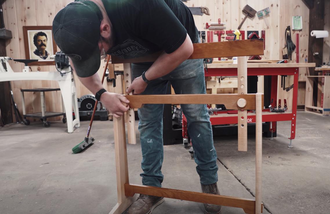 man assembling a sawhorse