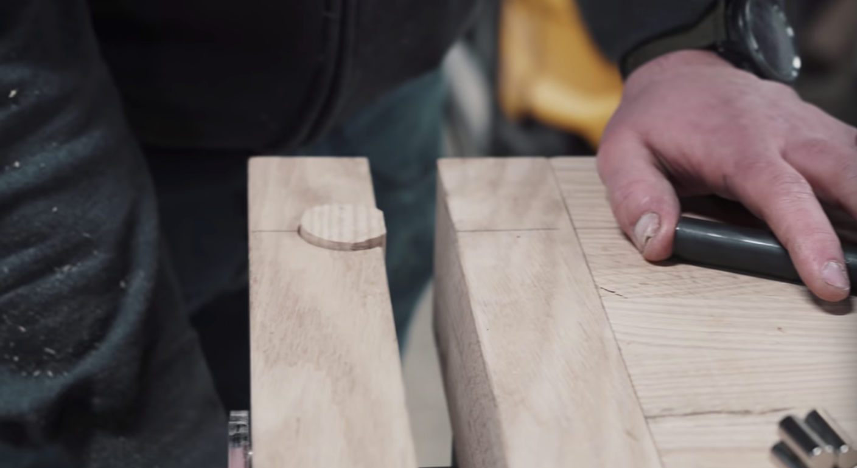 A man preparing wood