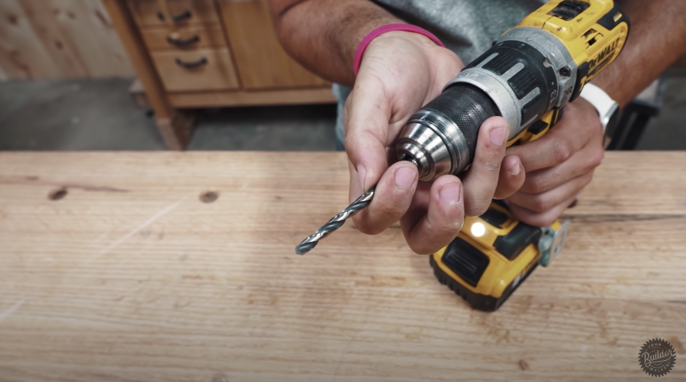 man holding a drill