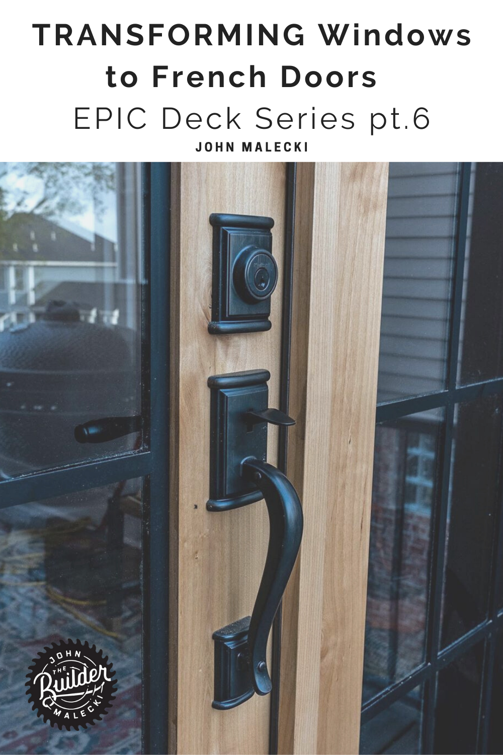 black door handle on wooden french door
